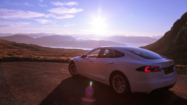 Whitecar Tesla at Applecross Pass on the North Coast 500
