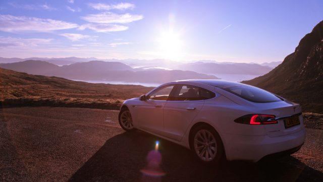 Whitecar Tesla at Applecross Pass on the North Coast 500