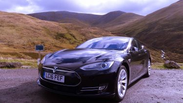 Tesla electric car near Glenshee