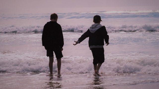 Two children in sea, Scotland